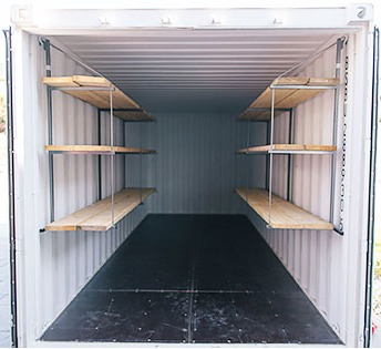 Shelving brackets and shelves in a shipping container