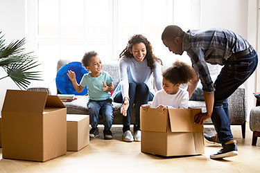 Family packing boxes for long distance move