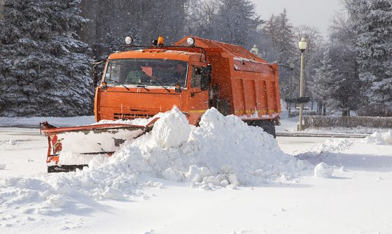 Truck plowing snow - winter moving tips