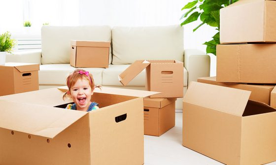 Child with moving boxes - Moving tips for parents with toddlers