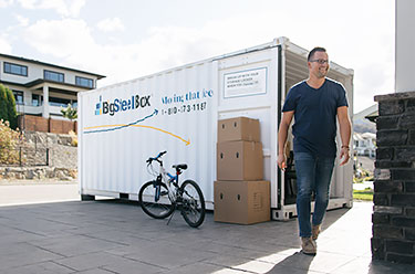 What's the cheapest way to move across Canada? - BigSteelBox in driveway