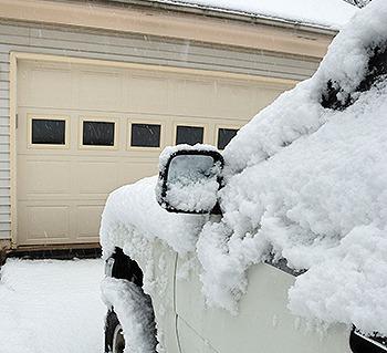 Snowy car in driveway