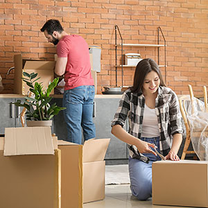 Couple unpacking from a move to the city