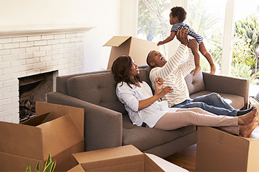Family with toddler unpacking after move