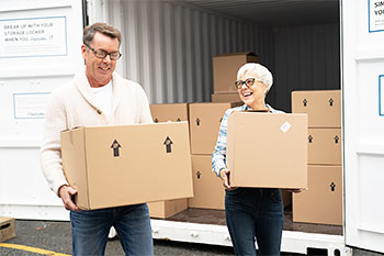Retired couple packing a BigSteelBox when downsizing homes