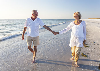 Retired couple on beach - where do you want to live after retiring?