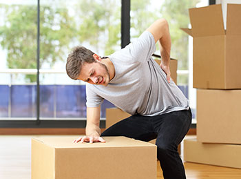 Man with injured back from moving