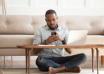 Man testing wifi after moving