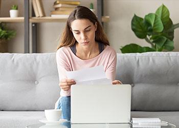 Woman at computer reviewing financials